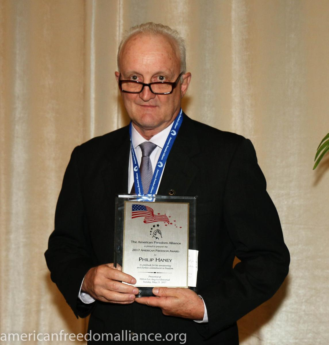 phil_haney_with_award