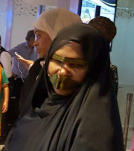 Muzzled woman in Abu Dhabi Photo by Philippe Karsenty